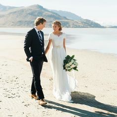 modest wedding dress with draped lace sleeves and a flowing skirt from alta moda (modest bridal gown)