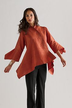 Silk Angel Shir  All the architectural beauty and asymmetrical syling of the classic Angel Shirt, reimagined in sensual 100 percent washed silk shantung and vibrant color. Button closures on sleeves to adjust length. Silk shantung.  Shown in Spice.