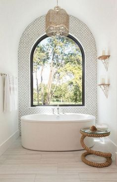 Dewayne Morehead saved to bathroom Bath Nook Arched Bath Nook with marble mosaic accent tile, freestanding tub, arched window and beaded chandelier Arched Bath Nook Bathroom Interior Design, Modern Interior Design, Home Design, Interior Decorating, Design Design, Bathroom Lighting Design, Modern Interiors, Bath Design, Interior Paint