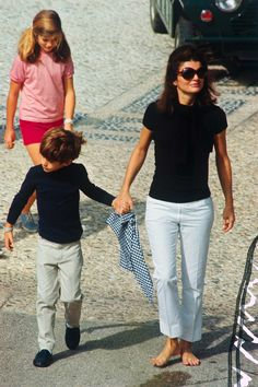 Jacqueline Kennedy, with their children, Caroline and John, Jr., on the island of Skorpios, 1968