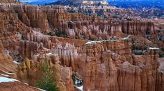 The 'Amphitheatre' of Bryce Canyon National Park. At Bryce Canyon , erosion has shaped colourful limestone, sandstone and mudstone into thousands of spires, fins, pinnacles, and mazes. Collectively the amazing formations are called 'hoodoos'.