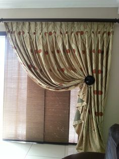 Sliding door covering option... sliding bamboo blinds behind a complementary dummy curtain