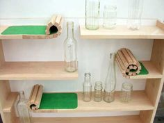 Rolling shelf by Catherine Greene - some sections are made of thin pieces of wood covered in fabric so they can be rolled back to accommodate taller objects.