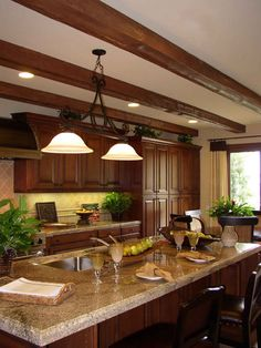 Our heavy sandblasted faux wood beams go great with the cabinets in this kitchen design.   http://www.fauxwoodbeams.com/images/image_70.jpg