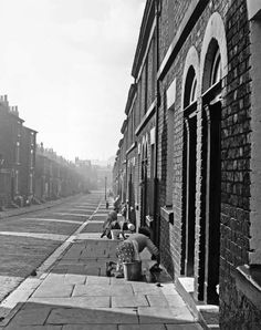 JOHN CHILLINGWORTH Housewives scrubbing their front doorsteps in Liverpool. Original Publication: Picture Post - 7105 - The Best And The Worst Of British Cities - Liverpool - pub. 1954 (Photo by John Chillingworth/Getty Images) Liverpool England, Liverpool Home, Liverpool Street, Vintage Photography, Street Photography, Social Photography, Photography Journal, Liverpool History, Salford