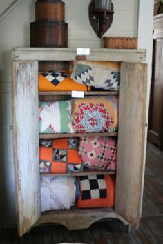 Vintage Quilts...in a prim cupboard.