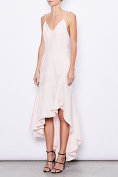 MLM LABEL Resort 17 Romance Linen Midi Dress Quartz. The Romance Dress has a form-fitting style which cascades into a mid-length, layered bottom. The strikingly elegant style has details of thin shoulder straps, a side-split and a draped back, owing to The Romance Dress's lively and sultry spirit. Crafted from 100% Linen in Quartz.