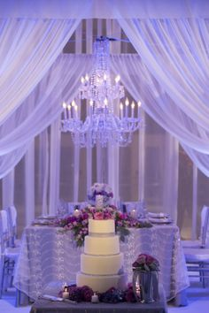 head table bling; wonderful idea to place cake in front of head table on low table, lots more decorations and wow factor