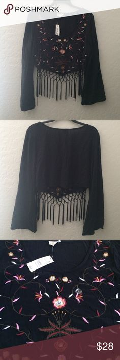 "Pacsun size Large crop top with fringe, NWT L.A. Hearts 💕 Brand from Pacsun. Black, long sleeves and a crop top. Size large, measures about 21"" from pit to pit and 14"" from back neckline to bottom hem. It's 100% rayon and is a gauze material. Beautiful embroidery in front. About 7"" of fringe in the front only. Boho and super cool! 😎   New with tags! LA Hearts Tops Crop Tops"