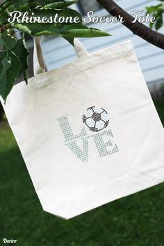 A girl can never have too many tote bags and this rhinestone DIY Soccer tote is perfect for practice or game day. Learn how to make your own today!