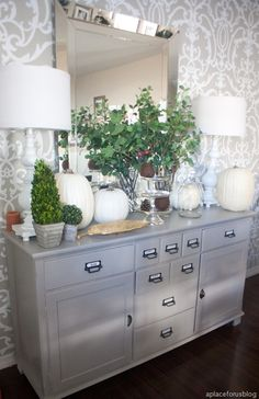 Sherwin Williams Functional Gray.. love the color of the sideboard