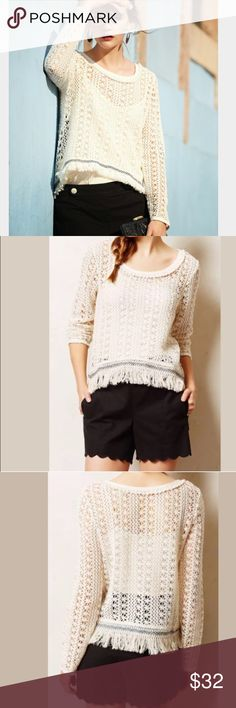 "🎉Anthropologie Akemi + Kin Franja Pullover🎉 Beautiful Anthropologie Akemi + Kin ivory open knit pullover sweater.  Features navy ribbon trim and fringe.  Says medium but runs small.  Check measurements.  Chest is 38"" and length is 21"".  In excellent condition. Anthropologie Tops"
