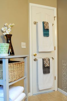 Great for a guest bathroom!! Love the towel rods on the back of the door! #diy #home #decor