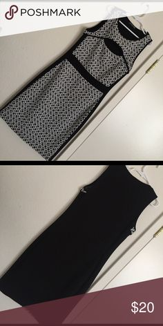 Dress Black and white patterned dress with a simple yet classy cut out on the front of the dress. Perfect for a fancy dinner night! Dresses Midi