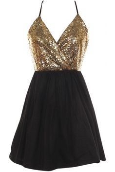 Sequin top with puff bottom and cross back100% PolyesterLength: 34.5