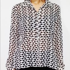 Freebird triangle peplum blouse Brand new with tags. Freebird blouse with triangle print. Fitted peplum design. High low cut. Flattering seams. Genuine shell buttons. Cuffed long sleeves. Classic collar. Freebird Tops Blouses