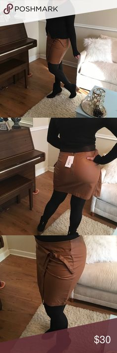 """JustFab brown faux leather wrap skirt BRAND NEW! Super cute and stylish faux leather skirt. Very sexy wrap skirt with a side buckle and back zipper. Measures approx. 19"""" and is 100% rayon. The one I'm modeling is a large. The one I'm selling is a medium and has never been used not even to model or try on. Comes with original packaging. Works great as a gift. JustFab Skirts A-Line or Full"""