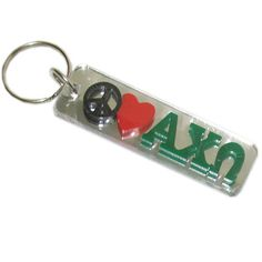 This Alpha Chi Omega #Peace #Love Keychain comes exactly as shown. There is a mirrored background on both the front and the back of the #keychain. #Greek #Sorority #Accessories #AlphaChiOmega #AChiO