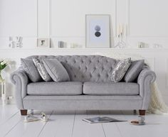 The Lacey Chesterfield Grey Plush Fabric Three-Seater Sofa is upholstered in a plush grey fabric that covers the deep-filled seat cushions and padded body, resulting in a highly comfortable piece of furniture. Pool Furniture, Cheap Furniture, Pallet Furniture, Living Room Sofa, Living Room Furniture, Living Rooms, Sofa Layout, Unique Sofas, Furniture