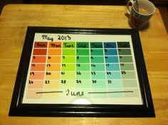 DIY calendar out of an old picture frame and paint samples