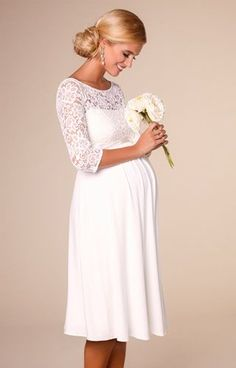 Beautifully designed using bold stretch floral lace, our Lucia short maternity wedding dress is super luxurious.