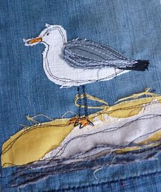 Seagull by Loopy Linnet. To thread paint directly on a ready-made, lined jacket, stabilizing all layers by applying a patch of fabric to the lining with temporary adhesive and hooping all layers. Stitch, then trim the patch around the stitching. Repeat with other design elements. myb Freehand Machine Embroidery, Free Motion Embroidery, Free Machine Embroidery, Embroidery Applique, Thread Painting, Sewing Appliques, Landscape Quilts, Seagull Craft, Fabric Birds