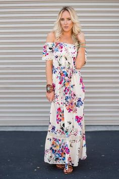 Made to turn heads this Off The Shoulder Floral Ivory Maxi Dress will keep all…