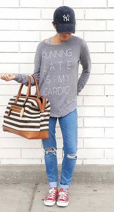 street style: sweatshirt + bag + rips + sneakers