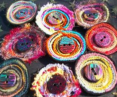 https://flic.kr/p/7QiDTf | button brooches_3 by McAnaraks | brooches made from yarn scraps and finished off with my own handmade buttons www.flickr.com/people/mcanaraks/