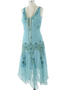 Floaty aqua silk chiffon dress reminiscent of Deco Era fashions.  A stunning look for spring/summer, especially for Roaring 20s or Downton Abbey themed events and weddings. Add a wide brimmed hat for a garden party, or jeweled, feathered headband for evening, T strap or Mary Jane pumps, long strands of pearls, and a fringed wrap to complete your elegant vintage inspired look.
