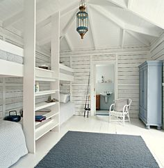 White Wood Built-In Bunk Beds via Scandinavian Retreat | Remodelista painted paneling cupboard for clothes