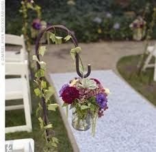 Mason jars or wine bottles with flowers for aisle runners?   Google Image Result for http://www.xoedge.com/ImageStage/Objects/0003/0086181/large_image.jpg