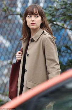 Back in the saddle: Dakota Johnson was seen back in her signature role as Anastasia Steele...