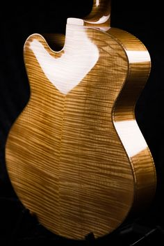 Flamed Maple back archtop guitar with Cremona Finish
