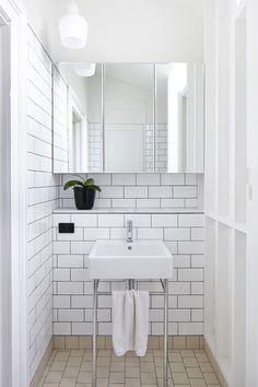Bathroom in New Farm Arbour House designed by Owen and Vokes and Peters. *subway tiles + white + ledge + rectangle sink + mirror cabinet span* Photo Alicia Taylor. via The Design Files daily http://thedesignfiles.net/2013/08/interview-paul-owen-stuart-vokes-and-aaron-peters-of-owen-and-vokes-and-peters/
