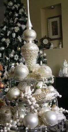 WHITE ORNAMENTS ON A CUPCAKE HOLDER.