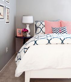 Soft gray walls teamed with contrasting patterns make a pretty bedroom.