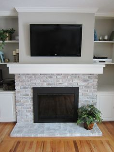 White-washing brick fireplace – Home Staging In Bloomington Illinois White Wash Brick Fireplace, Painted Brick Fireplaces, Fireplace Doors, Brick Fireplace Makeover, Home Fireplace, Fireplace Design, Fireplace Ideas, Fireplace Whitewash, Painting A Fireplace