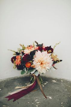 Totally romantic fall wedding bouquet with dark red and pink autumn blooms.