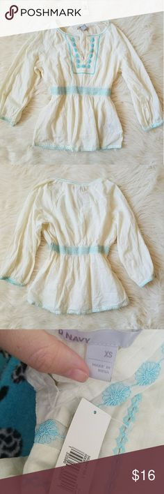Nwt Boho Peasant Top Cream with light blue details.  Waist band is stretchy.  As well as the sleeves.   Brand: Old Navy  Size: extra small Condition: NWT, no flaws at all. Perfect condition.  #peasant #peasanttop #hippie #hippiechic #boho #bohemian #bohochic #embroidery #summer #summerfashion #summerstyle #fashion #style #cheap #styleforcheap #xoxopf #bundleandsave Tops Blouses