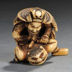 "Ivory Netsuke of Watanabe Tsuna, Japan, 19th century, dressed in samurai armor, suppressing an Oni by twisting its left arm to the back, inlaid eyes signed ""Masakazu"" to base, ht. 1 1/8 in."