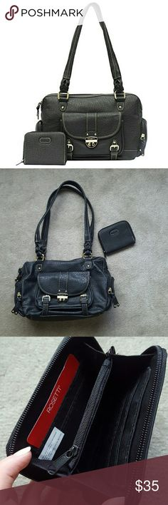 NEW! Rosetti Highlander Handbag + Wallet BRAND NEW - LIKE-BRAND NEW CONDITION. Rosetti black Highlander Handbag with matching Rosetti wallet! 1 zipper compartments on each side, Front pocket compartment, cell phone holder on back, zipper compartments inside with 2 more cell phone holder compartments. PERFECT condition except one flaw inside (as shown in pictures) - small stain on cell phone compartment. Wallet has never been used! NO TRADES. Rosetti Bags Shoulder Bags