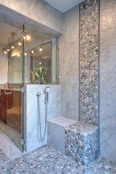 Stylish, Modern Bathroom Frameless glass shower panels and the shower door add to the contemporary feel of the space, and all bathroom fixtures contain a chrome finish with a stylish modern design. Contemporary Bathrooms, Modern Bathroom, Master Bathroom, Stone Bathroom, Bathroom Mirrors, Bathroom Faucets, River Rock Bathroom, River Rock Shower, Bathroom Cabinets