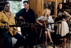 Joaquin Phoenix and Reese Witherspoon trained with old pros like Dolly Parton while preparing for their movie roles as Johnny Cash and June Carter. Photographed by Annie Leibovitz for Vogue, November 2005.