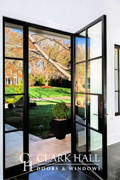 Custom iron front doors transform the design of any entrance. With large side lights with glass panels and windows to let in all the natural light, this modern, contemporary entry takes all of your exterior door ideas to the next level. Steel Doors And Windows, Custom Front Doors, Interior Barn Doors, Exterior Doors With Glass, House Entrance, French Doors Exterior, Exterior Front Doors, Exterior Design, Front Door