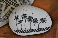 """Dandelions"" ~ pebbles from Portugal, hand painted by Sabine Ostermann"