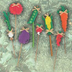 Create these fun veggie stakes to mark what you planted in each row of your vegetable garden. They are quick and easy with Perler Beads!