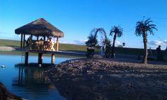 Create a beach around a pond complete with Tiki bar for wedding