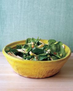 Lime zest and juice, minced habanero chiles, honey, and chopped pineapple make a spicy, exotic dressing for this chicken salad. Drizzle the dressing over watercress, spinach, toasted cashews, and shredded chicken breasts just before serving.