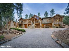 901 N Indian Paintbrush Circle, Payson, AZ 85541 — This spectacular mountain retreat overlooking the 7th hole is known as ''The Log Mahal''. This is perfect for the ultimate golfer/outdoorsman.   Elegantly sprawling over 16,000 sq ft it features 9 bedrooms, 10 bathrooms, maids' quarters, 3 full kitchens, an 1800s-style saloon, wine cellar, private elevator, 6 fireplaces, full-size arcade, heated/AC play house and a 6-car garage. Elegant attention to detail is displayed with 175 year-old…